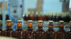 Beer bottles with crown caps Stock Footage
