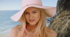 Closeup of an attractive woman smiling on a sunny beach Stock Footage