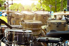 Acoustic drum set on stage before the concert Stock Photos