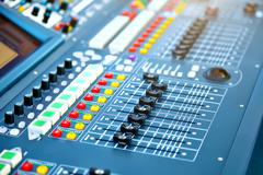 Big mixer console in a concert stage - stock photo