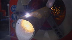 Laser cutting of metal tubes. Sparks fly outside of equipment Stock Footage