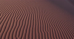 4K close-up panning shot of ripples in the sand dunes inside the Namib-Naukluft Stock Footage