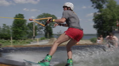 Wakeboard Active Lifestyle Extreme Sports grind on a rail setup slow motion Stock Footage
