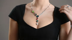 necklace on the neck. breast closeup - stock footage
