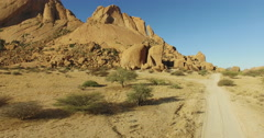 4K aerial view of granite peaks of the Spitzkoppe mountains Stock Footage