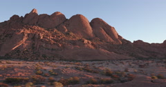 4K panning shot of the granite peaks of the Spitzkoppe mountains Stock Footage