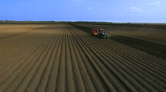 Planting Potatoes With Tractor.The Planter on the Field. Stock Footage