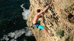 Climber Climbing On A Rock - stock footage