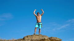 Climber Raising Hands - stock footage