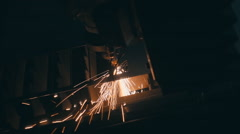 Laser cutting of metal. Sparks fly around.  Slow mo, slo mo Stock Footage