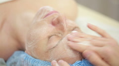 Face of women getting a spa treatment. deep facial cleansing Stock Footage