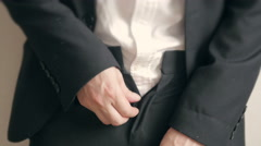 Businessman can t cope with the button trousers. Overweight businessman Stock Footage