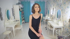 Portrait of a young beautiful brunette girl in beauty salon - stock footage