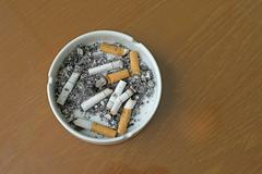 smoked cigarettes in white ashtray - stock photo