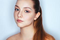 Glamour close up portrait of young beautiful woman model with trendy makeup Stock Photos