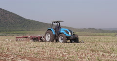 4K tractor ploughing a field Stock Footage