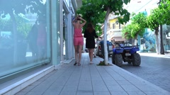 Two girls are walking around the city. 4K Stock Footage