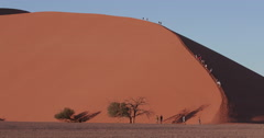 4K view of tourists climbing dune 45  inside the Namib-Naukluft National Park Stock Footage