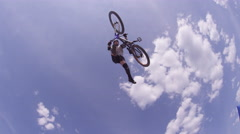 Mountain Bike Rider Tail Whip Against Sky - Jump over the camera Stock Footage