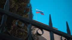 Waving a Russian flag on the building on a background of blue sky Stock Footage