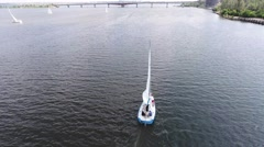 Sailing yacht with sails on river view from above Stock Footage
