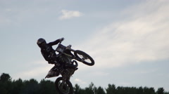 FMX silhouette bike whip - freestyle motocross Stock Footage