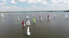 Sailboats deploy additional sails at the start of the competition Stock Footage