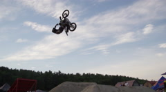 Extreme Freestyle Motocross Jumping back flip slow motion at dusk Stock Footage