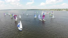 sailboats deploy additional sails at start of competition - stock footage