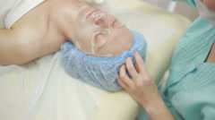 Face of women getting a spa treatment. deep facial cleansing. ultrasound Stock Footage