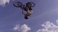 Extreme Sport BMX Back Flip against cloudy blue sky - mountain biking - stock footage
