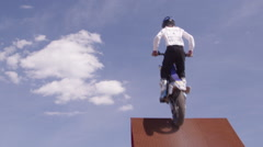 Extreme Freestyle Motocross Jumping on ramp - stock footage