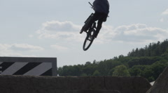 Extreme Sport Mountain Bike BMX Trick - Silhouette on dirt jump Stock Footage