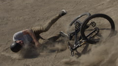 Slow motion mountain bike crash - rider falls in the dirt - stock footage