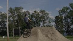 Extreme Sport BMX Dirt Jumping over the trees Stock Footage