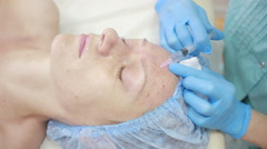 Cosmetic treatment with injection in a clinic. skin fortification - stock footage