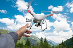 Hovering drone and a hand Stock Photos