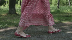 Girls feet in motion from the top, long dress, slow motion fps96 Stock Footage