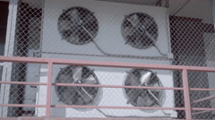 Air conditioning unit with four rotating fans on the wall of the building Stock Footage
