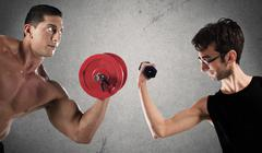 Ironic comparison of muscle strength Stock Photos