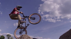 Extreme Mountain Bike Trick on Big dirt jump Stock Footage