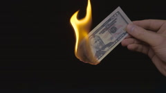 Burning bill of $ 50 on the black background. Slow mo, slo mo Stock Footage