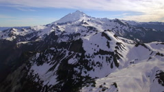 Cinematic Aerial Flight Over Snowy Mountains to Reveal Mt Baker on Sunny Day. Stock Footage