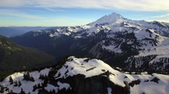 Epic Helicopter View of Snowy Cascade Mountain Range with Mt Baker Stock Footage