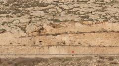Palestinian Kids throwing stones on Israeli road Stock Footage