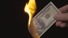 Incineration of $ 100 bills on a black background. Slow mo, slo mo Stock Footage