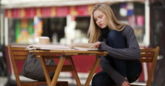 Portrait of young attractive woman reading books for research paper Stock Footage