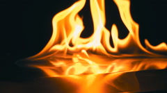 A lit match ignites gasoline. Blue Wave at the forefront of fire go to meet Stock Footage