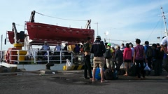 People boarding the ferry to go to Con Dao island Stock Footage