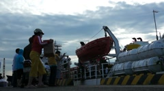 People boarding ship to Con Dao island. People bringing goods to the ship. Stock Footage